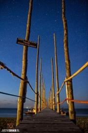 Steiger van veerboot de Vriendschap tussen Texel en Vlieland onder een sterrenhemel / Over Scaffolding ferry Friendship between Texel and Vlieland under a starry sky