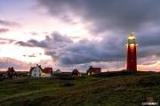 Vuurtoren van Texel tijdens een stromachtige zonsondergang / Texel lighthouse during a stormy sunset.